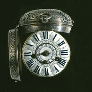 Round watch with index and alarm