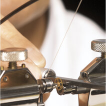 A tool for hand-polishing arbor pivots when fitted to a bow lathe