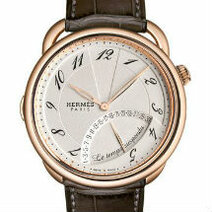 Hermès: Arceau Temps Suspendu, rose gold/2011