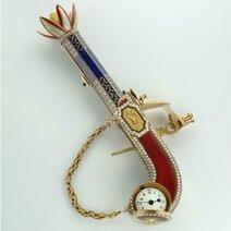 Pistol-shaped brooch watch and perfume spray