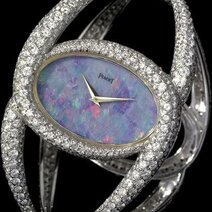 Piaget: Cuff watch with opal dial, 1,000 brilliants/1971,